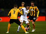 CAMBRIDGE, ENGLAND - JANUARY 23:  Radamel Falcao Garcia of Manchester United battles for the ball with Greg Taylor and Liam Hughes of Cambridge United during the FA Cup Fourth Round match between Cambridge United and Manchester United at The R Costings Abbey Stadium on January 23, 2015 in Cambridge, England.  (Photo by Julian Finney/Getty Images)