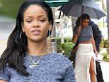 Rihanna-shows-leg.jpg