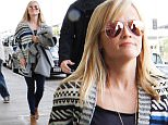 Reese Witherspoon catches a flight out of town a day after losing Outstanding Performance by a Female Actor to Julianne Moore at the SAG awards. January 26, 2015 X17online.com