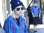 UK CLIENTS MUST CREDIT: AKM-GSI ONLY EXCLUSIVE: 'American Horror Story' starlet Emma Roberts headed to Nine Zero One Hair salon in West Hollywood on Tuesday afternoon for a touch up on her platinum blonde locks. The 23-year-old actress channelled the nineties with her trendy grunge look, rocking a beanie and plaid flannel over a lace slip dress and leather slip ons.  Pictured: Emma Roberts Ref: SPL937519  270115   EXCLUSIVE Picture by: AKM-GSI / Splash News