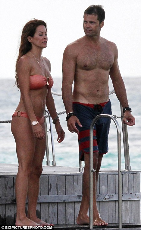 Hot bodies: Brooke Burke and David Charvet show off their toned physiques as they relax at the beach in St Barths, France yesterday