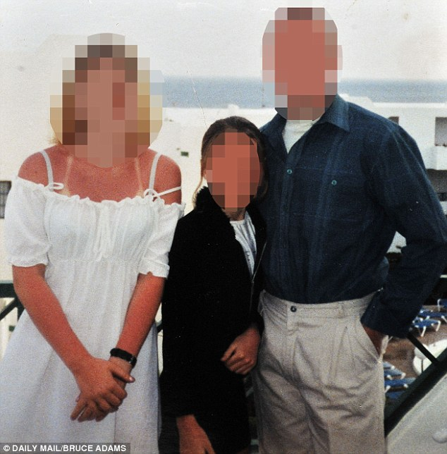 Happier times: Katie is pictured on holiday with her parents, aged 12