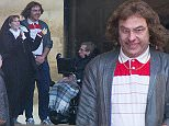 PIC BY GEOFF ROBINSON PHOTOGRAPHY 07976 880732.\n Pic show David Walliams and Catherine Tate filming at St John's College Cambridge on Wednesday afternoon Jan 28th  for a sketch for Red Nose Day.A stand in actor played Stephen Hawking (in chair) for rehearsal  until the real Prof Hawking arrived for his scene later in the day.\nComedian David Walliams has been spotted filming a sketch for Comic Relief with Catherine Tate and Professor Stephen Hawking.\nThe actor was seen dressed as the character Lou from Little Britain, who looks after wheelchair-bound Andy, played by Matt Lucas, in the series.\nBut yesterday (Wed) Matt Lucas was replaced by Professor Hawking in the comedy sketch, which is due to be broadcast on Red Nose Day (March 13).\nWalliams was also joined by comedian Catherine Tate, who was dressed as a nun, as they filmed the scenes in the grounds of St John's College in Cambridge.\nThe comedians initially rehearsed the scenes with a stunt double for Hawking, but the disabled