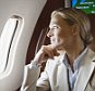 Executive looking out of window on airplane --- Image by   Bernd Vogel/Corbis