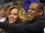Singer Beyonce, left, and Jay-Z watch during the first half of an NBA basketball game between the Los Angeles Clippers and the Brooklyn Nets, Thursday, Jan. 22, 2015, in Los Angeles. (AP Photo/Mark J. Terrill)