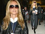 """Los Angeles, CA - Supermodel Heidi Klum made her way through Los Angeles International Airport on Friday afternoon. The 41-year-old Project Runway host recently opened up about her career. """"I was never a catwalk model,"""" Heidi recently told the 'Sydney Morning Herald.' """"I never really fit in the clothes. I was always too curvy, I was always a lingerie model, even when I was still in Germany when I won my modeling contest I would do lingerie and swimsuits because I was always too curvy for high fashion.""""\n \nAKM-GSI           January 30, 2015\nTo License These Photos, Please Contact :\n \n Steve Ginsburg\n (310) 505-8447\n (323) 423-9397\n steve@akmgsi.com\n sales@akmgsi.com\n \n or\n \n Maria Buda\n (917) 242-1505\n mbuda@akmgsi.com\n ginsburgspalyinc@gmail.com"""
