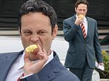 """Actor Vince Vaughn wearing a blue suit while eating an apple on the set of """"Unfinished Business"""" filming in Los Angeles Ca.\nFeaturing: Vince Vaughn\nWhere: Los Angeles, California, United States\nWhen: 21 Jan 2015\nCredit: Cousart/JFXimages/WENN.com"""