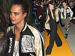 Inglewood, CA - Khloe Kardashian, Cara Delevingne and Kendall Jenner arrive at Sam Smith's concert at The Forum in Inglewood.  The hot trio joined Kim Kardashian inside the show.  Cara, who was dressed in a satin jacket and camo pants, showed off her edgy side shaved hairstyle.  Khloe greeted her fans with a smile and wave, while her half-sis Kendall looked a little embarrassed by all the attention from the screaming crowd. AKM-GSI          January 29, 2015 To License These Photos, Please Contact : Steve Ginsburg (310) 505-8447 (323) 423-9397 steve@akmgsi.com sales@akmgsi.com or Maria Buda (917) 242-1505 mbuda@akmgsi.com ginsburgspalyinc@gmail.com