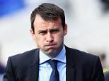 BIRMINGHAM, ENGLAND - OCTOBER 05:  Dougie Freedman (L), manager of Bolton Wanderers looks on during the Sky Bet Championship match between Birmingham City and Bolton Wanderers at St Andrews Stadium on October 05, 2013 in Birmingham, England,  (Photo by Matthew Lewis/Getty Images)