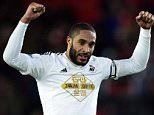 Swansea's Ashley Williams celebrates at the end during the Barclays Premier League match at St Mary's, Southampton. PRESS ASSOCIATION Photo. Picture date: Sunday February 1, 2015. See PA story SOCCER Souhampton. Photo credit should read: Adam Davy/PA Wire. RESTRICTIONS: Editorial use only. Maximum 45 images during a match. No video emulation or promotion as 'live'. No use in games, competitions, merchandise, betting or single club/player services. No use with unofficial audio, video, data, fixtures or club/league logos.