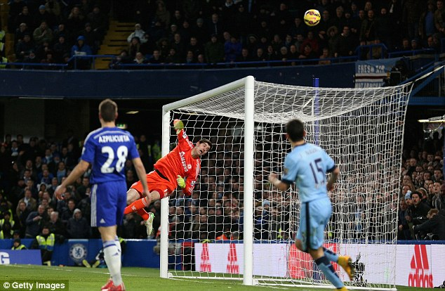 Chelsea stopper Thibaut Courtois makes a save to deny Manchester City a goal