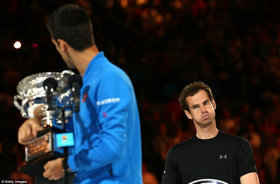 Murray eyes up Djokovic and his Australian Open trophy during the post-match presentations