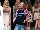 Alexander McQueen, British fashion designer, acknowledges applause at the end of the presentation of his Spring/Summer ready to wear 2006 collection in Paris, Friday Oct. 7, 2005. (AP Photo/Remy de la Mauviniere)  Lee Alexander McQueen committed suicide 11/02/2010 at the age of 40