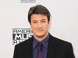 LOS ANGELES, CA - NOVEMBER 23: Actor Nathan Fillion arrives for the 42nd Annual American Music Awards held at Nokia Theatre L.A. Live on November 23, 2014 in Los Angeles, California.  (Photo by Albert L. Ortega/Getty Images)