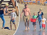 Please contact X17 before any use of these exclusive photos - x17@x17agency.com   Naomi Watts and Liev Schreiber take their kids to the beach for Superbowl week end in Malibu  feb 2, 2015 X17online.com