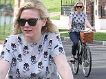 Picture Shows: Kirsten Dunst  February 01, 2015    'Fargo' actress Kirsten Dunst rides her bike to a friends house in Toluca Lake, California. Kirsten dressed casually in a print top and navy blue skinny jeans.    Exclusive All Rounder  UK RIGHTS ONLY    Pictures by : FameFlynet UK    2015  Tel : +44 (0)20 3551 5049  Email : info@fameflynet.uk.com
