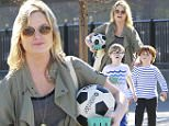 132047, Amy Poehler clutches a soccer ball as she spends time with her sons, Abel and Archie in Beverly Hills. Beverly Hills, California - Sunday, February 01 2015. Photograph: © PacificCoastNews. Los Angeles Office: +1 310.822.0419 sales@pacificcoastnews.com FEE MUST BE AGREED PRIOR TO USAGE