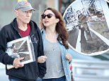 """UK CLIENTS MUST CREDIT: AKM-GSI ONLY\nEXCLUSIVE: Patrick Stewart goes out for a walk with his wife, Sunny Ozell in West Hollywood, and had a black and white photo of friend and """"X-Men: Days of Future Past"""" co-star, Ian McKellen, in hand.\n\nPictured: Patrick Stewart and Sunny Ozell\nRef: SPL940562  310115   EXCLUSIVE\nPicture by: AKM-GSI / Splash News\n\n"""