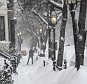 epa04601199 A person shovels a side walk in the Beacon Hill neighborhood as  snow falls in Boston, Massachusetts, USA, 02 February 2015.  A strong winter storm is hitting the Northeastern United States for the second time in a week after some of the Boston area already saw more than 30 inches (76 cm) a week ago.  EPA/JOHN CETRINO
