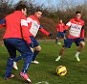 ST ALBANS, ENGLAND - FEBRUARY 06:  (L-R) Santi Caszorla, Aaron Ramsey, Gabriel and Theo Walcott of Arsenal during a training session at London Colney on February 6, 2015 in St Albans, England.  (Photo by Stuart MacFarlane/Arsenal FC via Getty Images)