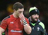 06.02.15 - Wales v England - RBS 6 Nations 2015 - George North of Wales leaves the field with team doctor Geoff Davies.