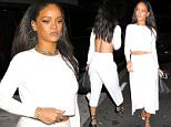 Rihanna looked amazing at Giorgio Baldin in Santa Monica.  The pop star was dressed in white, showing off her abs, on Friday, February 6, 2015  X17online.com