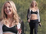132280, Kate Hudson seen with models on a photoshoot for her Fabletics brand. Los Angeles, California - Friday February 6, 2015. Photograph: KVS, © PacificCoastNews. Los Angeles Office: +1 310.822.0419 sales@pacificcoastnews.com FEE MUST BE AGREED PRIOR TO USAGE