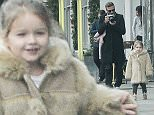 EXCLUSIVE ***MINIMUM FEE APPLIES OF £750 PER PAPER***David Beckham is seen out in westbourne grove photographing his daughter Harper, looking like a photoshoot for vogue, david really got into his roll as paparazzi.\n4 February 2015.\nPlease byline: Vantagenews.co.uk