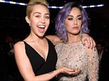 LOS ANGELES, CA - FEBRUARY 08:  Miley Cyrus and Katy Perry attend The 57th Annual GRAMMY Awards at STAPLES Center on February 8, 2015 in Los Angeles, California.  (Photo by Kevin Mazur/WireImage)