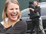 UK CLIENTS MUST CREDIT: AKM-GSI ONLY\nEXCLUSIVE: Cameron Diaz looks happy and excited as she meets a friend outside the dance studio in Los Angeles.\n\nPictured: Cameron Diaz\nRef: SPL945674  070215   EXCLUSIVE\nPicture by: AKM-GSI / Splash News\n\n