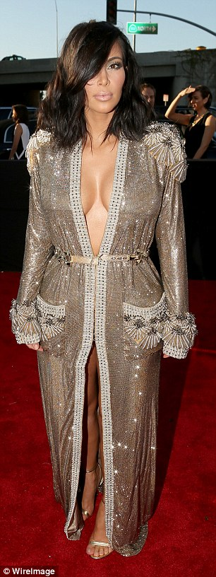 Flaunting their stuff on Grammy night: Both Kim Kardashian (left) and Beyonce (right wore plunging dresses that showed off their chests at the Grammy Awards on Sunday