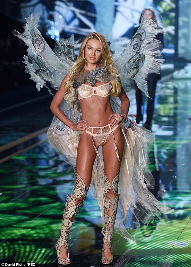 What she looks like on the job: The South African beauty on the Victoria's Secret show in December