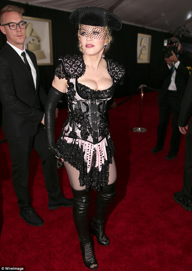 Ole! Madonna (flanked by DJ Diplo, left) shimmied her HUGE cleavage while dressed as a sexy matador on the Grammy red carpet