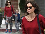 UK CLIENTS MUST CREDIT: AKM-GSI ONLY EXCLUSIVE: Actress Minnie Driver enjoys a beautiful afternoon with her son, Henry, as they grabbed lunch to-go from Joan's on Third. The mother and son duo then went to Color Me Mine Studio to paint ceramics together.  Pictured: Minnie Driver and Henry Story Driver Ref: SPL945587  070215   EXCLUSIVE Picture by: AKM-GSI / Splash News