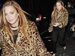 8 Feb 2015 - LONDON - UK\n*** EXCLUSIVE ALL ROUND PICTURES ***\n*** STRICTLY NOT AVAILABLE FOR MAIL ONLINE AND ANY ONLINE SUBSCRIPTION DEALS UNLESS FEE AGREED PRIOR TO USAGE***\nLINDSAY LOHAN ARRIVED WITH AND LEFT WITH A MYSTERY MAN IN A HAT AND LEATHER JACKET BUT THE PAIR WERE KEEN TO AVOID BEING PICTURED TOGETHER\nCELEBRITIES PICTURED AT THE BOX NIGHTCLUB FOR THE VENUE'S 4TH ANNIVERSARY.\nBYLINE MUST READ : XPOSUREPHOTOS.COM\n***UK CLIENTS - PICTURES CONTAINING CHILDREN PLEASE PIXELATE FACE PRIOR TO PUBLICATION ***\n**UK CLIENTS MUST CALL PRIOR TO TV OR ONLINE USAGE PLEASE TELEPHONE 44 208 344 2007**