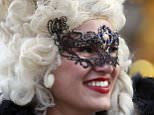 A masked reveller poses near Saint Mark's Square during the Venetian Carnival in Venice January 31, 2015. REUTERS/Stefano Rellandini   ( ITALY  - Tags: SOCIETY TRAVEL)