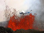 MAIN PHOTOT: A daring pilot flies his plane over a volcano as red-hot lava bursts into the sky.  The scorching lava, which is 850 degrees Celsius hot, erupts in the air up to heights of almost 200 feet. On board the little blue and white plane are sightseers, who get an up close view of the spectacular volcano, as they were just 300 metres away.  These stunning pictures were taken by photographer Baldur Sveinsson, who was in another plane flying around the volcano.  SEE OUR COPY FOR DETAILS. Pictured:  The plane flying over the volcano as red-hot lava bursts into the sky. Please byline: Baldur Sveinsson/Solent News © Baldur Sveinsson/Solent News & Photo Agency UK +44 (0) 2380 458800