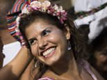 """Revelers dance during the 'Ceu na Terra', or Heaven on earth, carnival parade in Rio de Janeiro, Brazil, Saturday, Feb. 7, 2015. Rio's over-the-top Carnival is the highlight of the year for many local residents. Hundreds of thousands of merrymakers are beginning to take to the streets in open-air """"blocos"""" parties. (AP Photo/Felipe Dana)"""