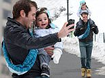 Perez Hilton in a snow bound Central Park playing with his son Mario on the swings and slide and sharing a 'selfie' to remember the occasion Featuring: Perez Hilton, Mario Armando Lavandeira III Where: Los Angeles, New York, United States When: 08 Feb 2015 Credit: Ivan Nikolov/WENN.com