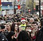 Sales: Tens of thousands of shoppers descended on Oxford Street on the penultimate Saturday before Christmas