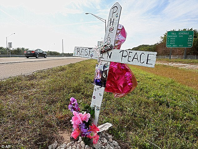 Simple tribute: A memorial has been set up in honor of the late Phoebe Jonchuck, 5, on the south side of the Dick Misener Bridge near the north end toll booths of the Sunshine Skyway Bridge
