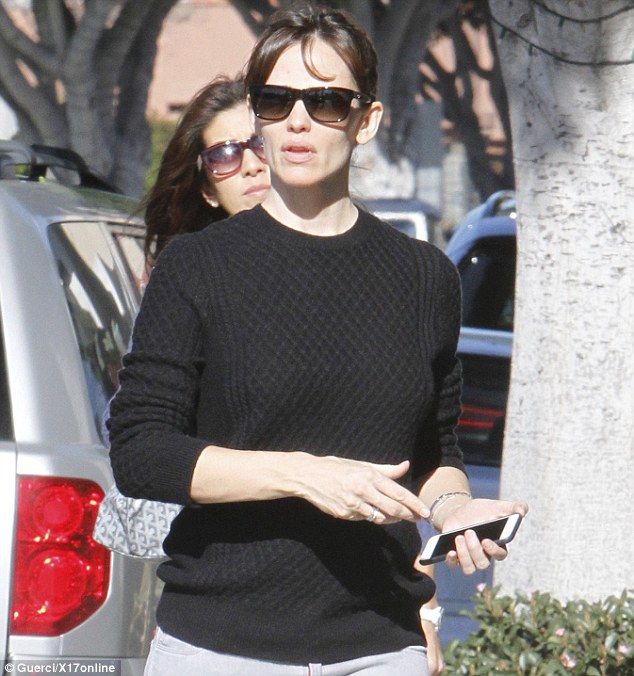 As casual as casual gets: The Dallas Buyers Club star wore a nondescript black sweater for her outing