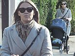 09.FEB.2015 - LONDON - UK *** EXCLUSIVE ALL ROUND PICTURES *** FORMER GIRLS ALOUD SINGER KIMBERLEY WALSH IS SEEN TAKING HER 5 MONTH OLD SON BOBBY FOR A WALK WITH A FRIEND IN LONDON, UK. BYLINE MUST READ : XPOSUREPHOTOS.COM ***UK CLIENTS - PICTURES CONTAINING CHILDREN PLEASE PIXELATE FACE PRIOR TO PUBLICATION *** **UK CLIENTS MUST CALL PRIOR TO TV OR ONLINE USAGE PLEASE TELEPHONE 0208 344 2007**