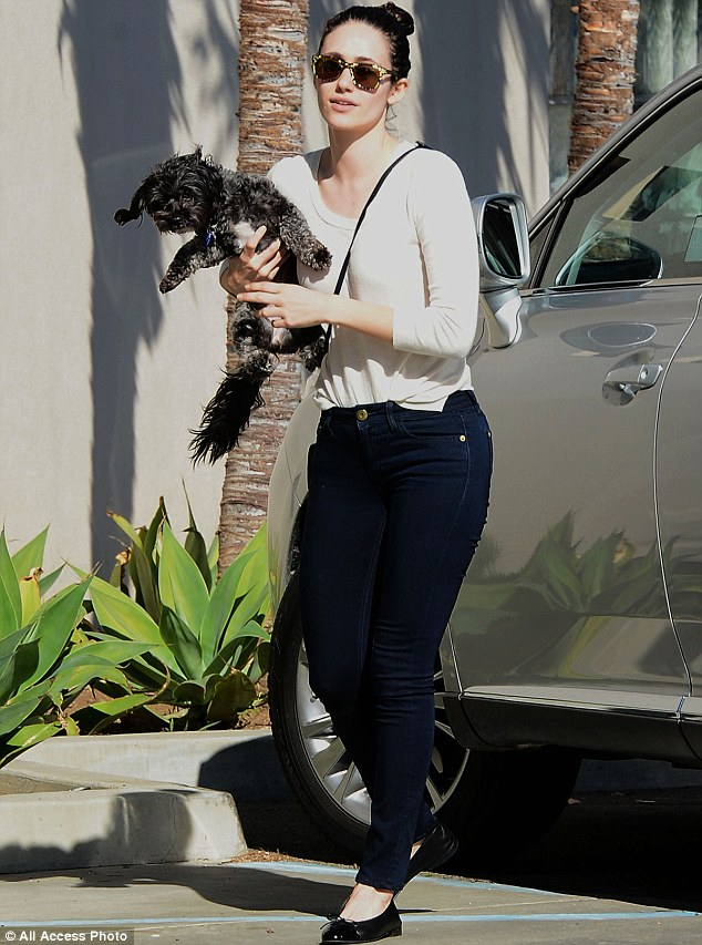Hurry inside: The 28-year-old actress wore a comfortable pair of black ballet flats as she rushed inside with pooch in hand