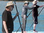 EXCLUSIVE: It's smooth sailing for lovebirds Neil Young and Daryl Hannah! The 69-year old rocker and the 54-year old actress invited friends to join them in a weekend trip to Santa Barbara, Calif., on Neil's carefully restored 101-foot Baltic trading schooner the 'WN Ragland' (named after his grandfather). Young has owned the yacht for over 30-years and has sailed around the world in the $600,000 vessel. Daryl and Neil had fun on their stand up paddle boards in the picturesque harbor. Neil filed for divorce from his wife of 36-years Peg last year and quickly struck up a romance with Daryl Hannah. The couple's 'love boat' was built in 1913, and is said to have a hippie vibe of 'Haight-Ashbury meets Swiss Family Robinson tree house.' Note the Canadian flag on the mast. Neil also tinkered with his classic Lincoln Continental car before paddle boarding. \\nBlink News +1.424.270.9694\\ngo@blink-news.com