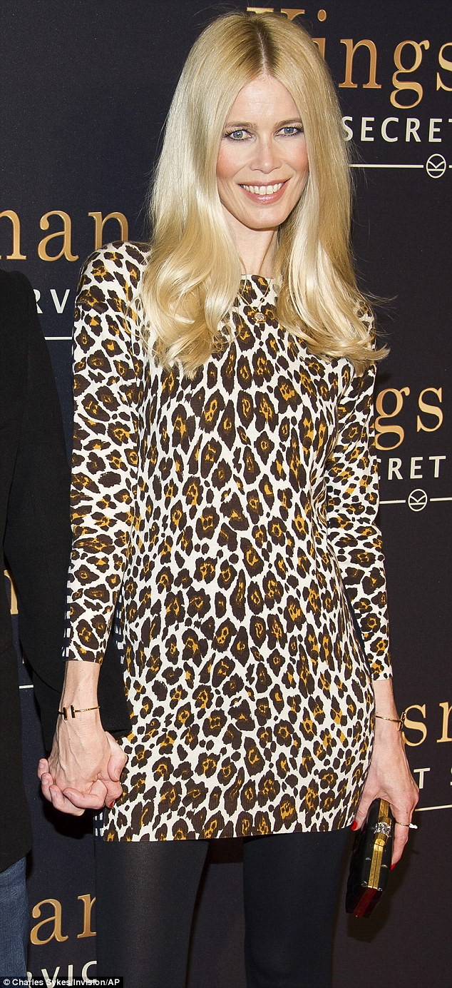 Meow: The 44-year-old supermodel looked fierce in a cheetah-print long sleeve mini dress