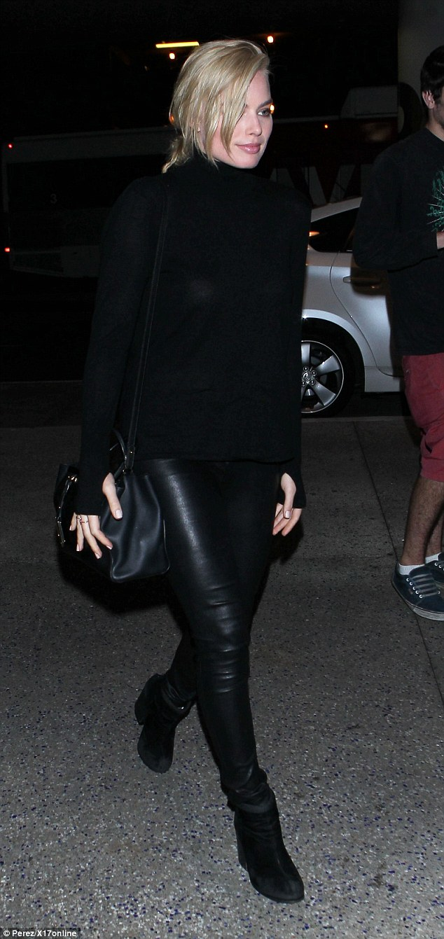 Sexy! Margot Robbie stopped for fans at LAX  wearing leather trousers as she signed autographs for fans of new movie Focus on Monday