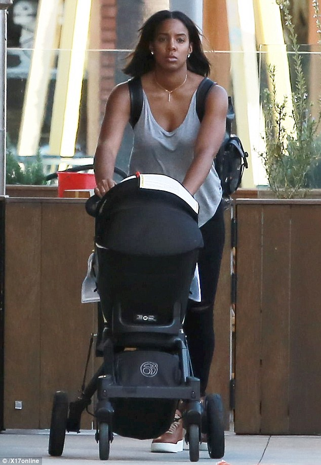 Toned: Kelly Rowland showed off her impressive arms during an outing with her son Titan on Monday in Los Angeles