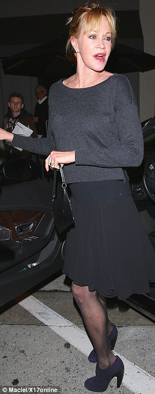 Sticking to one color: The 57-year-old actress - who is the mother of Fifty Shades Of Grey star Dakota Johnson - wore head-to-toe black