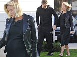 9 FEBRUARY 2015 MALIBU USA..EXCLUSIVE PICTURES..Soon-to-be parents Lara Bingle and Sam Worthington seen here exiting trendy Oliver Peoples store in Malibu after browsing for a new pair of sunglasses, Lara looked stunning as usual, this time, showing off her huge baby bump wearing a black maxi dress with a black leather jacket on top and sandals.
